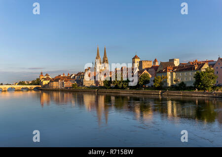 Old Town with the Stone Bridge and St. Peter's Cathedral on the Danube River, Regensburg, Bavaria, Germany - Stock Photo