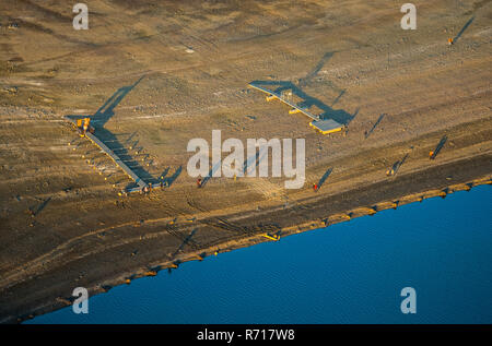 Aerial view, low water in the Möhnesee reservoir, wide shore area, moorings for boats are dry, Arnsberger Wald nature park Park - Stock Photo