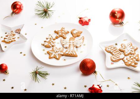 Christmas homemade gingerbread cookies and christmas tree on whi - Stock Photo
