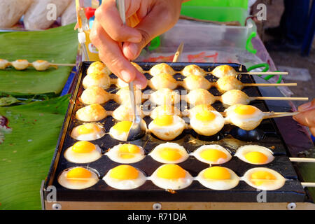 The Fried quail egg in a black hole pan. - Stock Photo