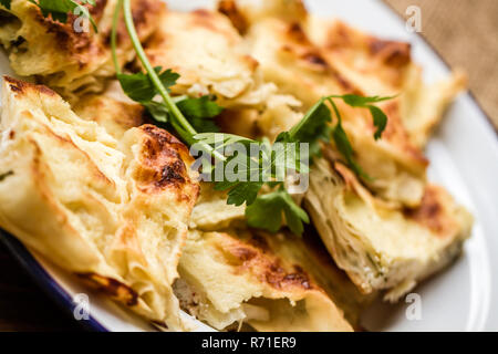 Homemade Delicious Turkish Style Cheese Pie in Enamel Plate - Stock Photo