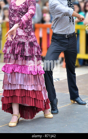 Two Flamenco dancers dancing in a show on the street - Stock Photo