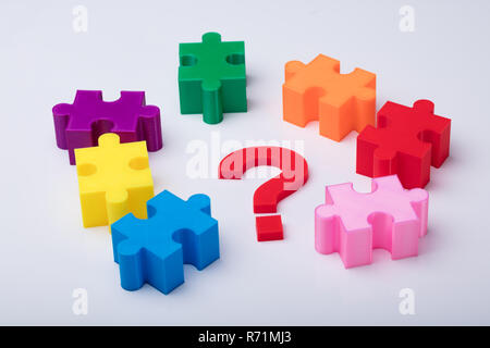 Close-up Of Multi Colored Jigsaw Puzzle - Stock Photo