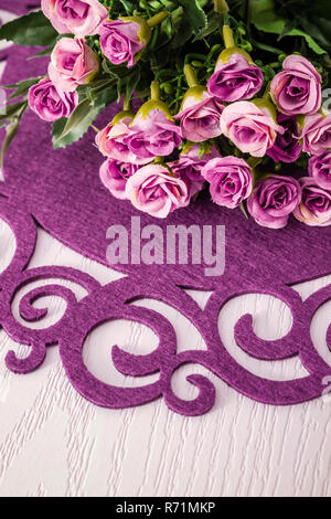 Dinner Table Arranged with Artificial Flowers and Colorful Runners - Stock Photo