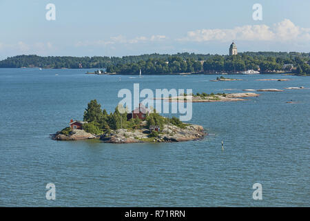 Houses surrounded by water and the banks of the Gulf of Finland near the port of Helsinki in Finland - Stock Photo