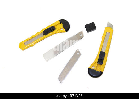 Construction knives on a white background Tools on a white background. Isolated objects. Items for repair and collection of furniture. - Stock Photo