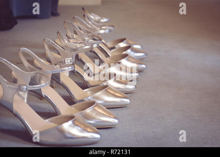 bridesmaids shoes in a line - Stock Photo