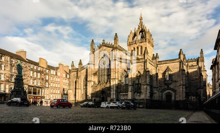 Edinburgh, Scotland, UK - November 7, 2018: Sun shines on the west face of St Giles's Cathedral, the High Kirk of Edinburgh, on the Royal Mile. - Stock Photo