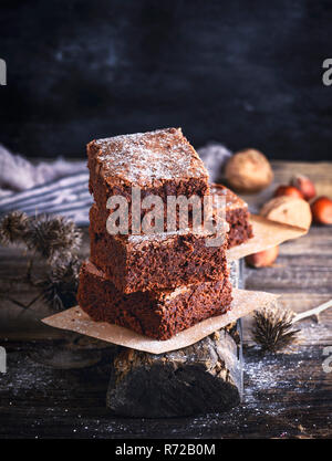 square pieces of chocolate baked brownie pie - Stock Photo