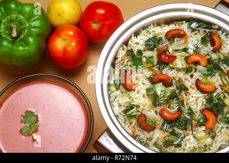 veg fried rice and cucum curry, indian meal, food from india - Stock Photo