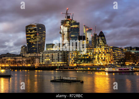 Looking across the River Thames to the river walk and the city in London - Stock Photo