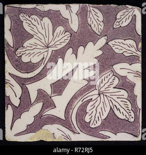 Sprinkled purple ornament tile, openwork stylized spiked leaves coming from corner, surrounded by creeper leaves, oak leaves, wall tile tile sculpture ceramic earthenware glaze, Baked 2x glazed painted Yellow shard square two nail holes. Purple on white. - Stock Photo