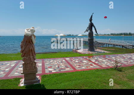 Pier of the Ruh Ordo Cultural complex named after famous Kyrgyz writer Chinghiz Aitmatov, Issyk Kul lake, Cholpon-Ata, Kyrgyzstan - Stock Photo