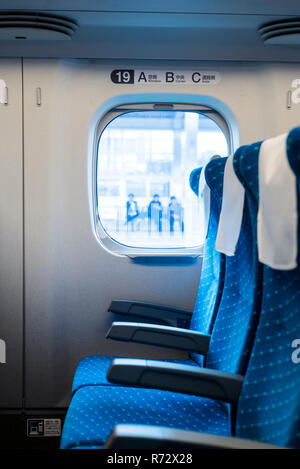 View outside of a Shinkansen bullet train - Stock Photo