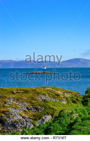 Lonely Small lighthouse on a rock in the nordic sea, Lofotens Islands, Norway. - Stock Photo