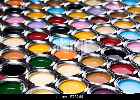 Creativity concept group of tin metal cans with color paint - Stock Photo