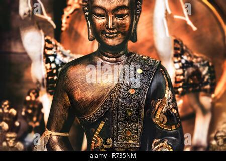 buddha meditating yoga background bronze orange statue - Stock Photo