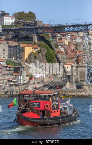Porto/Portugal - 10/02/2018 : View of river Douro, with recreational boat sailing, for touristic tours - Stock Photo