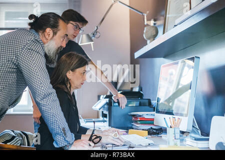 Couple working with son in home office - Stock Photo