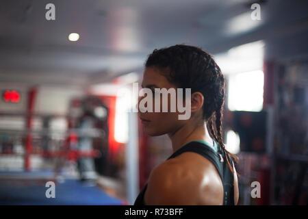 Female boxer in gym - Stock Photo