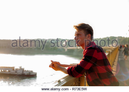 Man enjoying view from bridge, Budapest, Hungary - Stock Photo