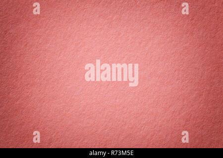 Texture of vintage dark pink paper background with vignette. Structure of dense light rose kraft cardboard with frame. Felt gradient backdrop closeup. - Stock Photo