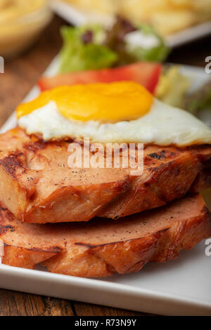 closeup of a bavarian leberkaese with egg - Stock Photo