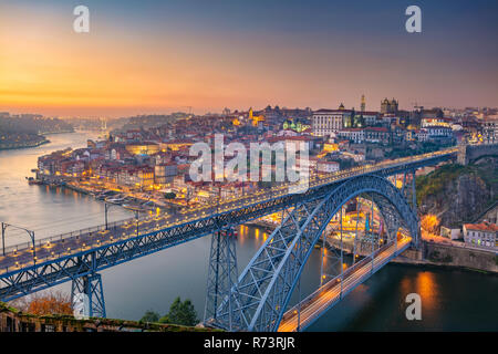 Porto, Portugal. Cityscape image of Porto, Portugal with the famous Luis Bridge and the Douro River during sunset. - Stock Photo