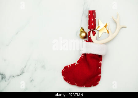 Christmas stocking lay flat composition - Stock Photo