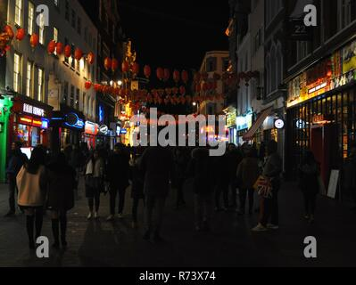 Pedestrians on Wardour Street, Soho, London, UK. - Stock Photo