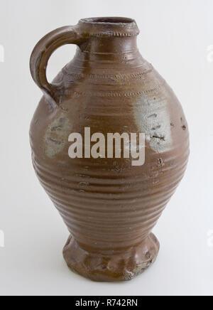 Dark brown stoneware jug be pinched, jug crockery holder