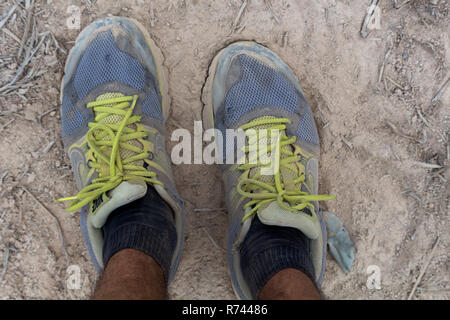 Don Daeng, Laos - April 27, 2018: Dirty ruined spor shoes after two months of walking - Stock Photo