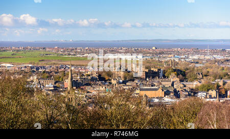 Lancaster, England, UK - November 12, 2017: Winter sun shines on the cityscape of Lancaster and Morecambe, including Lancaster Castle and Cathedral, a - Stock Photo