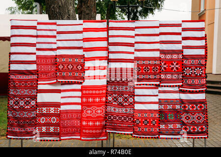 Linen Towels With Belorussian Ethnic National Folks Ornament On Clothes. Slavic Traditional Pattern Ornament Embroidery. Culture Of Belarus - Stock Photo
