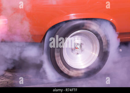 Drag Race Car warms up the tires with a burn out - Stock Photo