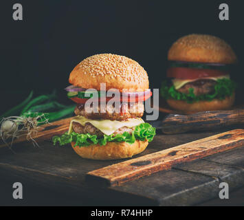 double cheeseburger in a bun with sesame seeds - Stock Photo