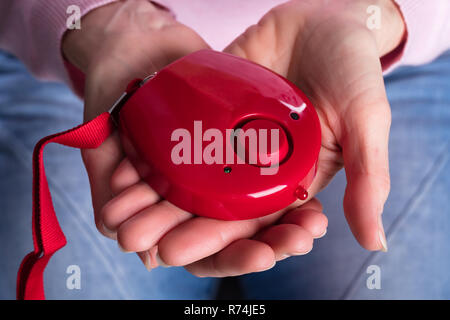 Woman Showing Personal Alarm Button - Stock Photo