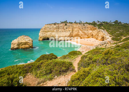 a view of beach in benagil fishing village on the coast of portugal - Stock Photo