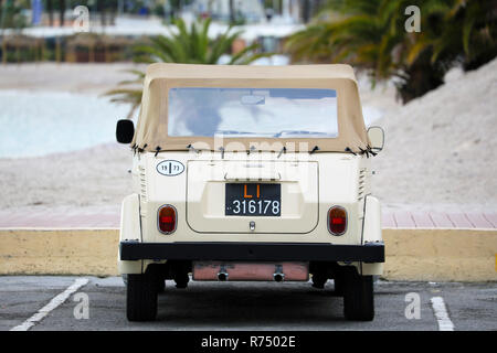 Menton, France - December 7, 2018:  Beautiful Vintage Volkswagen Thing 1973 (Rear View) Car On The Beach, Mediterranean Sea, French Riviera, Europe - Stock Photo