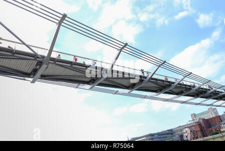 City, London, uk - June 8, 2018: Looking up at the structure of the millennium walking bridge that crosses over the river thames from St. Pauls to the - Stock Photo