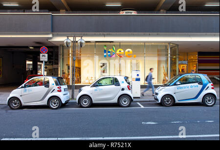 Electric vehicles from car sharing service car2go, in the city center of Stuttgart, at the central station, at charging stations, - Stock Photo