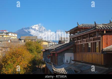 Jade Dragon Snow Mountain from Lijiang Ancient Town ,Yunnan ,China - Stock Photo