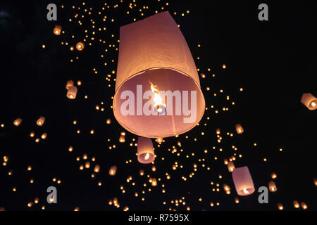 Tourist floating sky lanterns in Loy Krathong festival , Chiang Mai ,Thailand. - Stock Photo