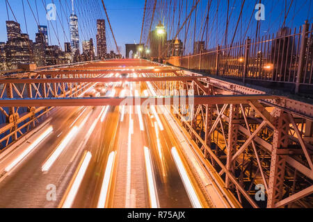 Night lights of car headlamps on the Brooklyn bridge. Long exposure - Stock Photo