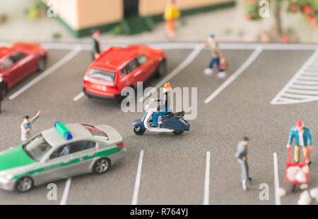 Policeman controlling traffic on a road on repair - Stock Photo