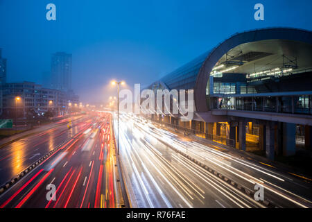 Traffic With Light Trail Next To The Train Station During Blue Hour