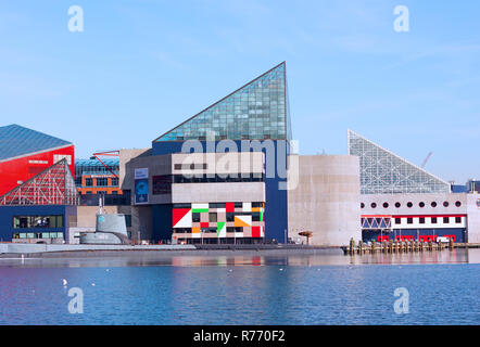 BALTIMORE, USA - JANUARY 31, 2014: National Aquarium and historic submarine Torsk at Inner Harbor on a cold winter day with reflection in ice. - Stock Photo