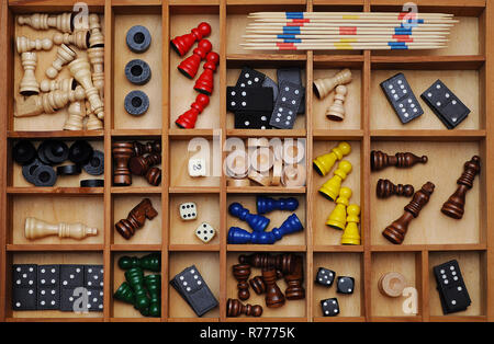 Wooden figures of board games, gaming pieces, dice, dominoes, Mikado sticks, games collection in a letter case