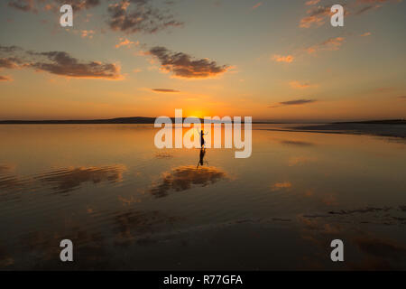 sunset and reflection in salt lake - Stock Photo