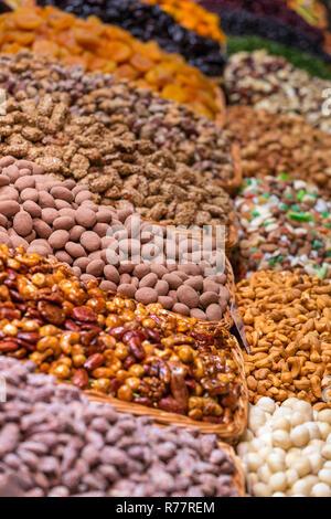 Dried fruits and nuts at the Mercat de Sant Josep de la Boqueria, a large public market in the Ciutat Vella district in Barcelona, Spain. - Stock Photo